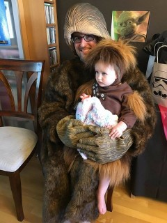 father and son dressed as chewbacca